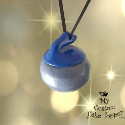 curling rock christmas ornament blue